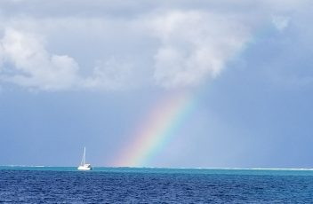 Catamaran and rainbow