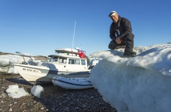 Self-Portrait and Grounded Expedition Boat, Hudson Bay, Nunavut, Canada